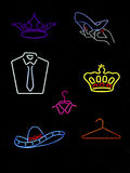 Neon Symbols & Signs. Several neon signs shaped like accessories royalty free stock photos