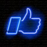 Neon Thumbs Up symbol on brick wall background Royalty Free Stock Photo
