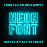 Neon tube alphabet font. Neon color type letters and numbers. Royalty Free Stock Images