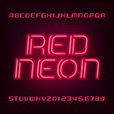 Neon tube alphabet font. Type letters and numbers. Blue color on a dark background. Neon tube alphabet font. Type letters and numbers. Red color on a dark Royalty Free Stock Photo