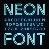 Neon tube alphabet font. Type letters and numbers. Royalty Free Stock Photography