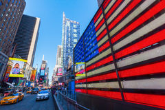 Neon US flag at Times Square, NYC. New York City, USA - October 06, 2015: US flag neon sign at Times Square, Manhattan. Times Square one of the worlds busiest stock photography