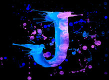 Neon watercolor paint - letter J Royalty Free Stock Images