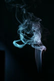 Neon wisp of smoke. Colorful neon wisp of smoke with black background Stock Photography
