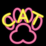Neon Yellow Cat with a Neon Pink Cat Paw. A blue neon dog paw with the word Dog in yellow neon Stock Images