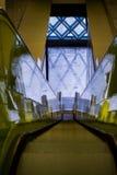 Neon yellow escalator Royalty Free Stock Image