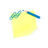 Neon yellow paper note with blue clips and blue pencil Royalty Free Stock Image