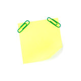 Neon yellow paper note with green clips Royalty Free Stock Images
