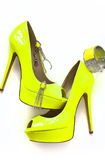 Neon Yellow Shoes. And blingy accessories Stock Photography