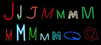 Neon-Zeichen J-M Q Lizenzfreie Stockfotos
