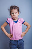 Neonata dell'aspetto europeo 6 anni di mani sopra Fotografia Stock