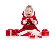 Neonata di risata del Babbo Natale con il contenitore di regalo Fotografia Stock