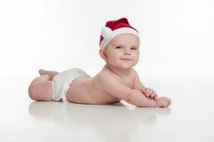 Neonata felice che indossa Santa Hat Fotografia Stock