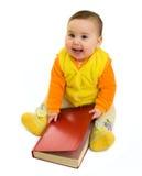 Neonata felice con il libro Immagine Stock Libera da Diritti