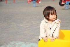 Neonata giapponese sullo scorrevole Fotografia Stock