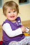 Neonata sorridente sveglia Fotografie Stock