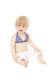 Neonata in un costume da bagno Immagine Stock