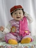 Neonata in vestito da Uigur Fotografia Stock Libera da Diritti