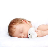 Neonato addormentato con il giocattolo Fotografie Stock Libere da Diritti