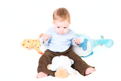 Neonato con i giocattoli Fotografie Stock Libere da Diritti