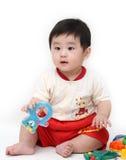 Neonato con i giocattoli Fotografia Stock
