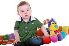 Neonato con i giocattoli. Immagine Stock