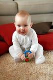 Neonato con i suoi primi giocattoli Immagini Stock Libere da Diritti