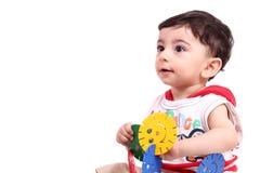 Neonato con il giocattolo Immagini Stock