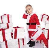 Neonato in costume del Babbo Natale con il telefono Immagini Stock Libere da Diritti