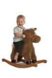Neonato sveglio che ride sul cavallo di oscillazione Fotografia Stock