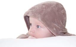 Neonato sveglio divertente in un cappuccio Fotografie Stock