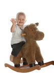 Neonato sveglio sul cavallo di oscillazione Immagini Stock