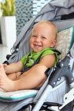 Neonato in un passeggiatore Fotografia Stock