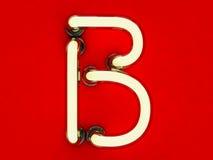 Neonowej tubki list na czerwonym tle Obrazy Royalty Free