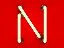Neonowej tubki list na czerwonym tle Fotografia Stock