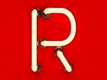 Neonowej tubki list na czerwonym tle Obraz Stock