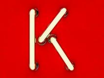 Neonowej tubki list na czerwonym tle Zdjęcia Royalty Free
