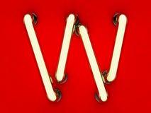 Neonowej tubki list na czerwonym tle Zdjęcia Stock