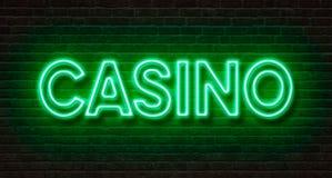 Neonowy znak na ściana z cegieł - kasyno Zdjęcia Royalty Free