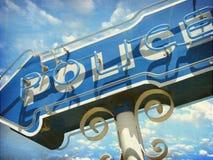 Neonpolizei kennzeichnet Stockfotografie