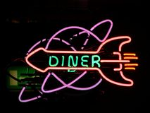 Neonsign diner. Light illuminated advertising stock image