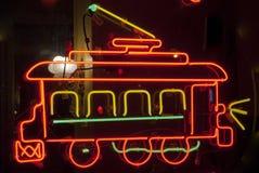 Neonspårvagn Arkivfoto