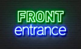 Neontecken för främre ingång på bakgrund för tegelstenvägg Arkivfoton