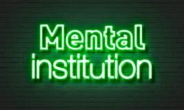Neontecken för mental institution på bakgrund för tegelstenvägg Fotografering för Bildbyråer