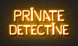Neontecken för privat kriminalare på bakgrund för tegelstenvägg royaltyfria bilder