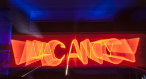 Neonzeichen der freien Stelle für Motel stockbild