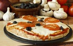 Neopolitan Pizza. Neopolitan or plain mozzarella cheese and tomato pizza Royalty Free Stock Photos