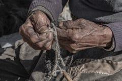 Nepale weaver braiding rope royalty free stock photo