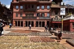 Nepal, Bhaktapur, Potters' Square. Potters' Square is not cherished square full of cultural sites, but if you are interested in the process of making royalty free stock images