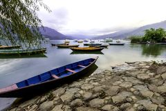 NEPAL COLORFUL BOATS IN PHEWA LAKE NEPAL stock images